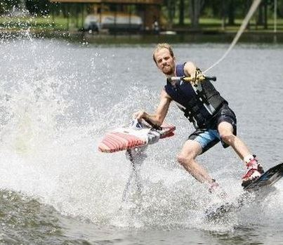 Extreme ironing while waterskiiing