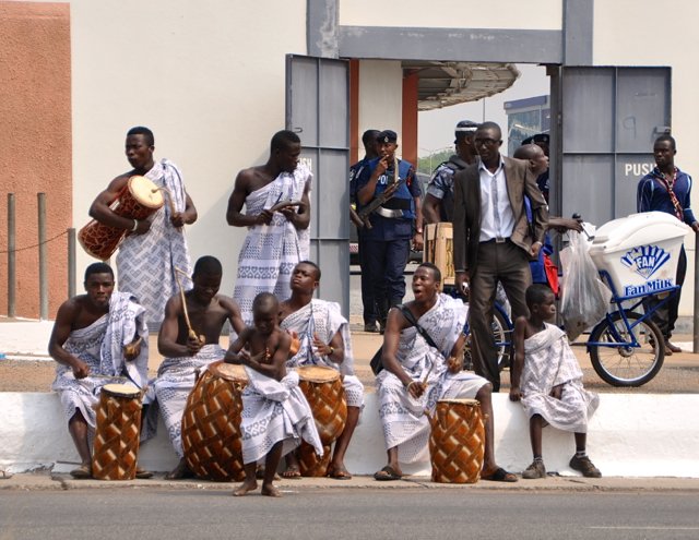 people dancing on the street at accra, president day